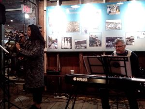 Feb 15, 2015 at the Cannery Farmer's Market. Maria wows everyone with her voice and Peter takes care of the keys!
